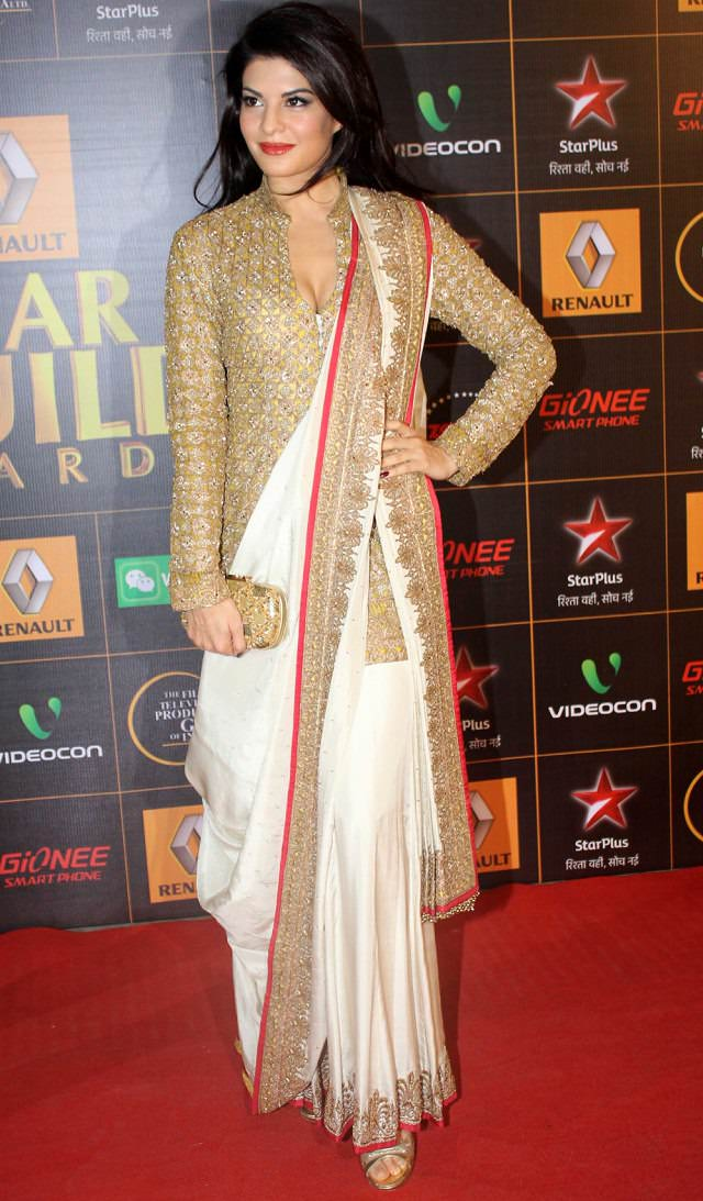jacqueline fernandez looks beautiful in white and golden saree