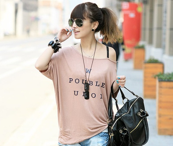 Wear oversized t-shirts as off shoulder way is new fashion trend
