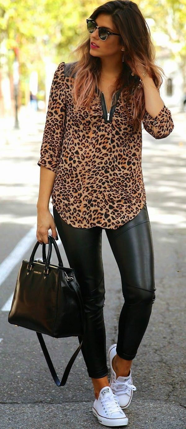 animal printed top with leather leggings