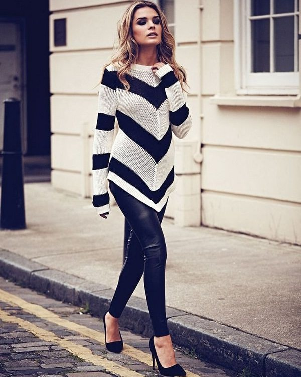 black & white sweater with leather leggings
