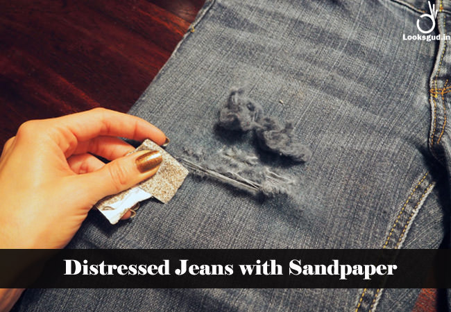 distressed jeans with sandpaper