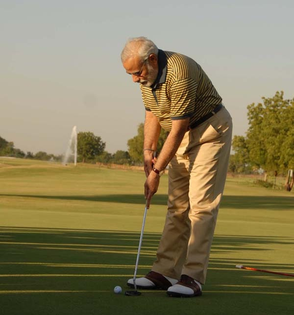 Modi in striped t-shirt and trousers