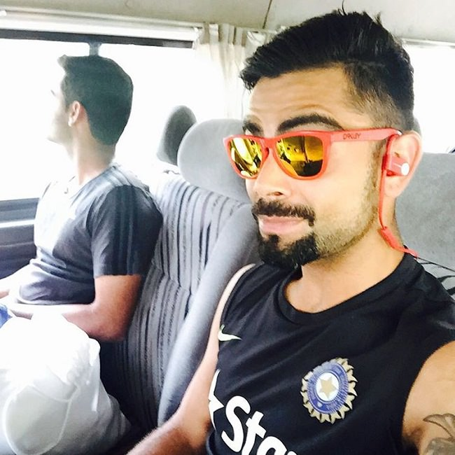 virat in red sunglasses