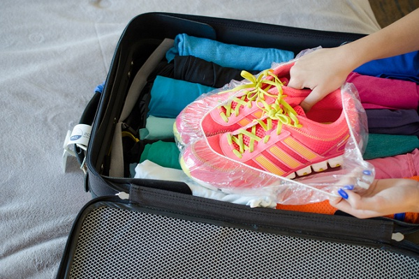 packing hacks encase shoes in shower caps for long trips