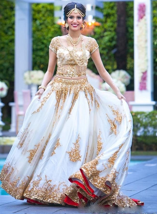 White Net & Lace Heavy works Bridal Lehengas are favorite of the Indian Bridal