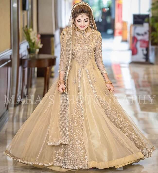 cream stone work bridal lehenga