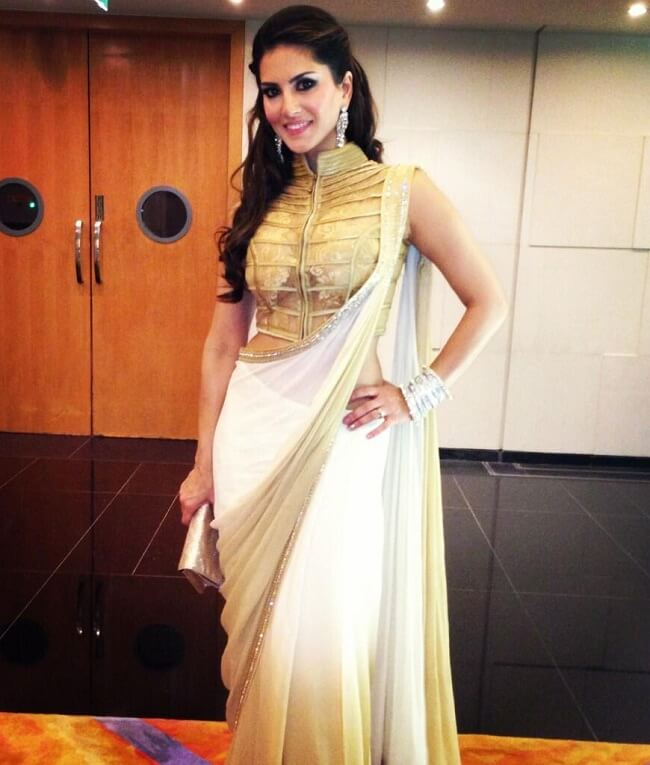 sunny in party wear white and golden saree
