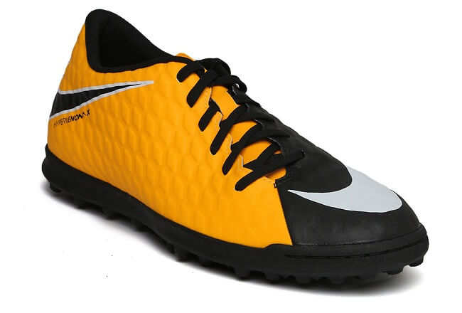 orange and black lace up football shoes