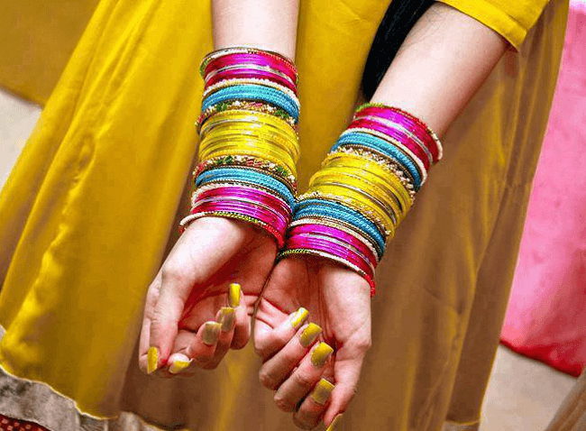 indian wedding bangles in hand
